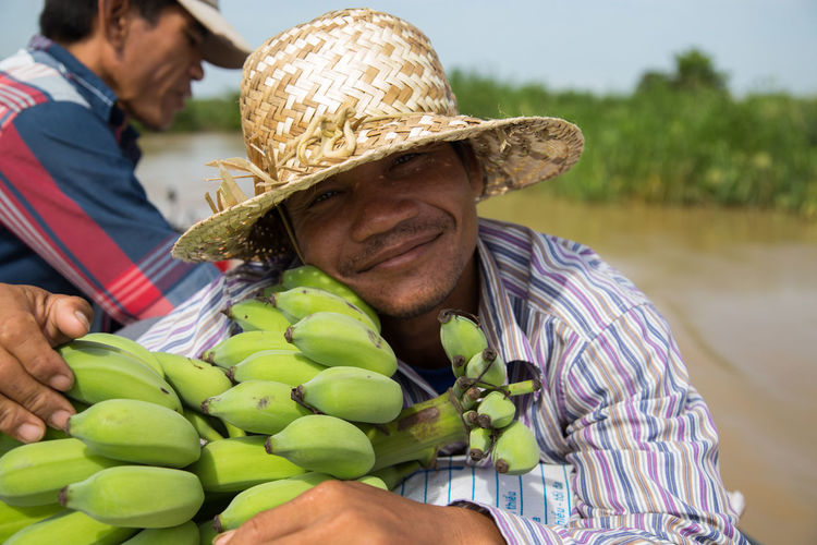 Banana Cambodia Trip Boat Trip Cambodia Tour Cambodian Day Focus On Foreground Food Food And Drink Freshness Fruit Hat Healthy Eating Mature Men Men Nature Outdoors Real People Two People