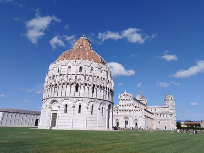 Piazza dei Miracoli, Pisa, Italy. The Purist (no Edit, No Filter) Incidental People Pisa Travel Destinations Summertime Blue Sky Blue Sky And White Clouds No Edit/no Filter Travel Photography Leaning Tower Of Pisa Famous Places Landmark Dome Baptistery Tower Tower Of Pisa Italy🇮🇹 Tuscany Summer Sunny Day Architecture Building Exterior Grass Cupola Tourism Famous Place Tourist Attraction