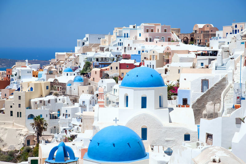 Oia, Santorini Architecture Blue Building Exterior Built Structure Church Clear Sky Dome High Angle View House Island Place Of Worship Religion Residential Building Residential District Residential Structure Roof Santorini Santorini, Greece Sea And Sky Seaside Spirituality Sunlight Town TOWNSCAPE Landscapes With WhiteWall
