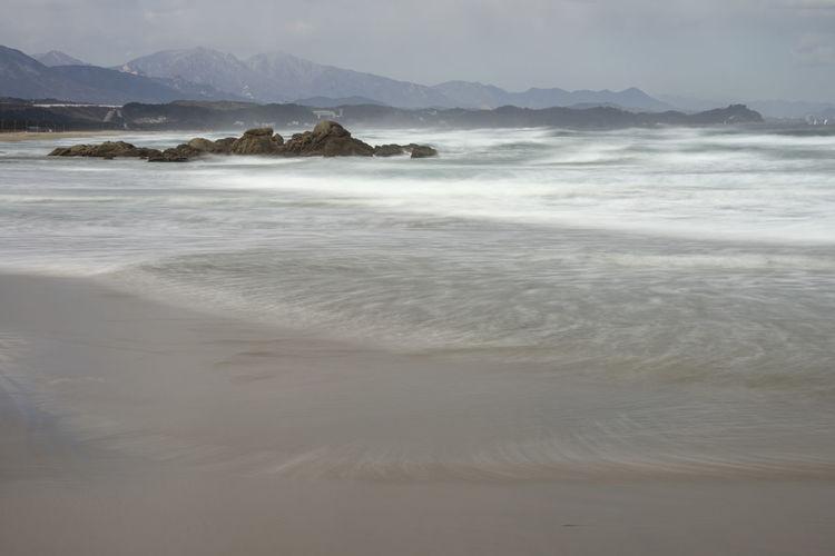 sea view of Hajodae Beach, Yangyang, Gangwondo, South Korea Beach Beauty In Nature Coastal Feature Coastline Day Hajodae. Horizon Over Water Long Exposure Nature No People Outdoors Sand Sea Surf Surge Vacations Water Wave Wave Winter