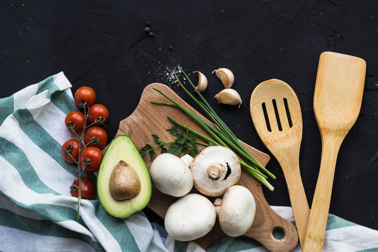 Black Background Directly Above Eating Utensil Food Food And Drink Freshness Fruit Healthy Eating Herb High Angle View Indoors  Kitchen Utensil No People Preparation  Raw Food Spice Still Life Table Table Knife Tomato Vegetable Wellbeing Wood - Material
