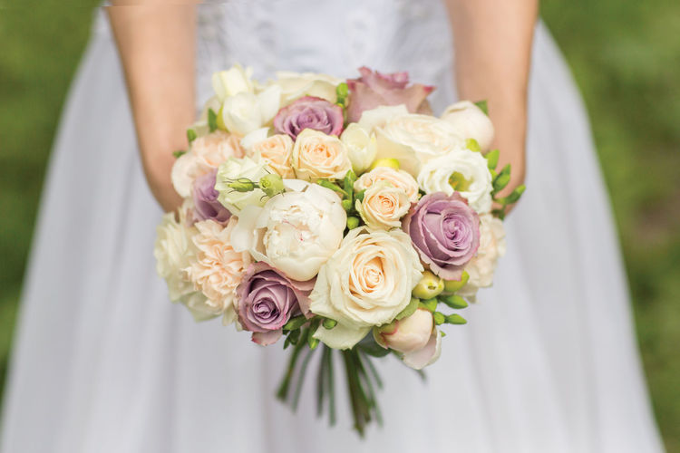 Close-Up Of Bride Holding Bouquet