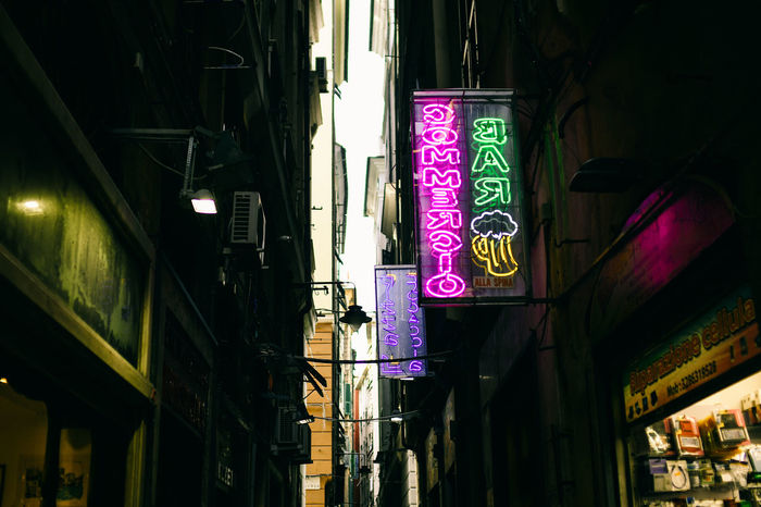 Narrow Street of Italy City Dark Narrow Shady Small Business Advertisement Architecture Building Exterior Built Structure City Illuminated Italy Low Angle View Moody Narrow Street Neon Neon Sign Night Outdoors Pollution Scary Shady Place Small Store Text Travel Destinations
