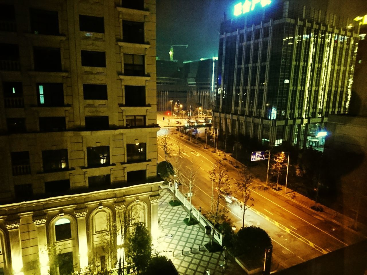 night, building exterior, city, architecture, illuminated, built structure, street, building, city life, transportation, high angle view, city street, cityscape, outdoors, nature, road, incidental people, office building exterior, residential district, office, skyscraper