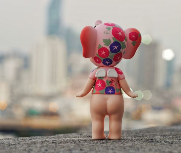 Rear view of girl standing in city