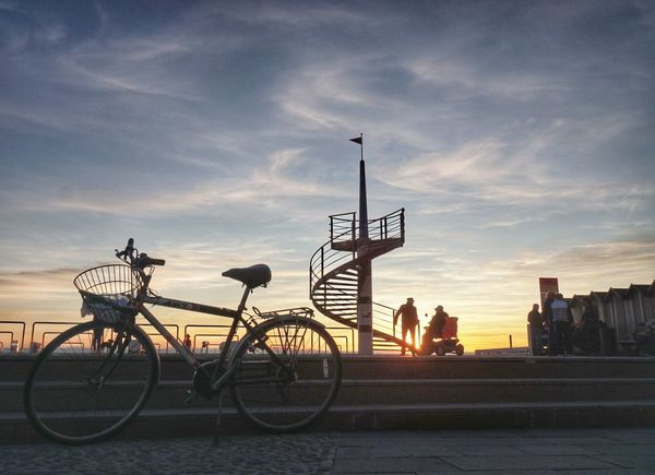 Bicycle Sunset Transportation City No People Travel Destinations Outdoors Night Road Sign Sky Architecture Cityscape Mobility In Mega Cities