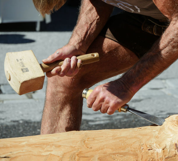Midsection of carpenter working outdoors