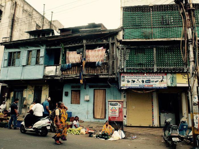 People on mahatma gandhi road against buildings