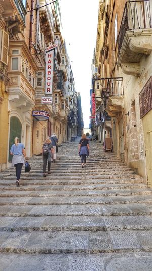 Stairs and steps in Valetta, Malta Architecture Building Exterior Built Structure City Day Full Length Leisure Activity Lifestyles Low Angle View Men Outdoors People Real People Sky Steps The Way Forward Two People Walking Women