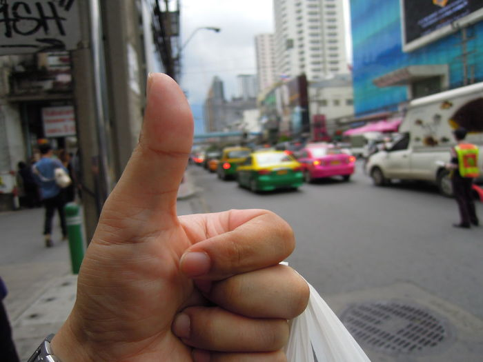sarcastic , Thumbs up of traffic jam in bangkok Architecture Bangkok Building Car City City Life Close-up Closeup Day Human Hand Metropolis Outdoors Road Sarcastic Street Street Photography Streetphotography Taxi Thailand Thumbs Up Thumbs Up ! Traffic Traffic Jam Trafficjam