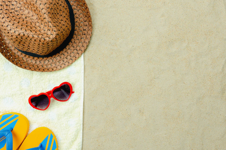 Beach Close-up Copy Space Day Directly Above Eyewear Fashion Glasses High Angle View Holiday Land No People Outdoors Personal Accessory Sandal Shoe Slipper  Still Life Summer Sunglasses Trip