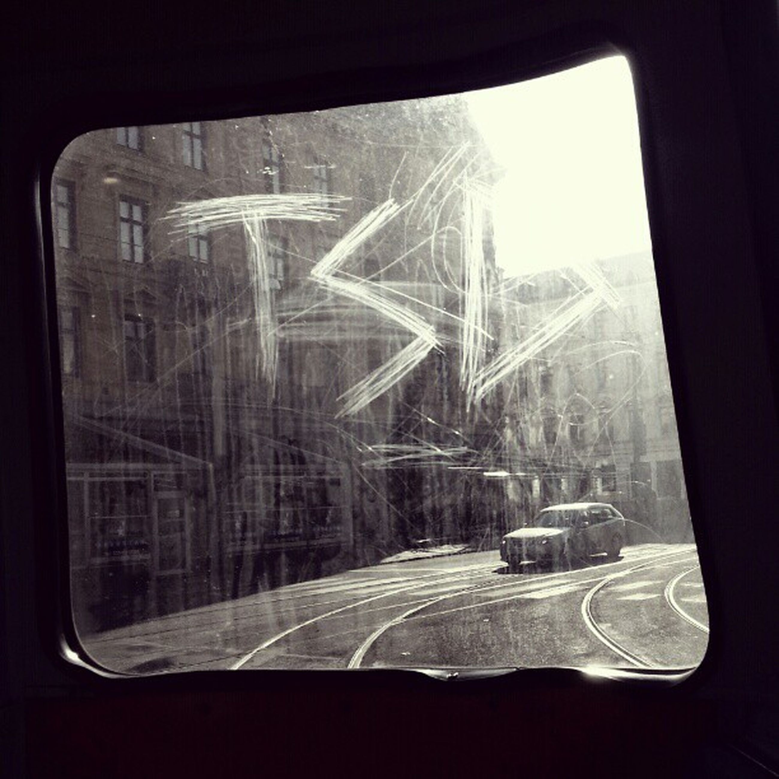 glass - material, window, transparent, transportation, vehicle interior, indoors, mode of transport, car, land vehicle, looking through window, glass, windshield, travel, reflection, car interior, public transportation, day, sunlight, sun, side-view mirror