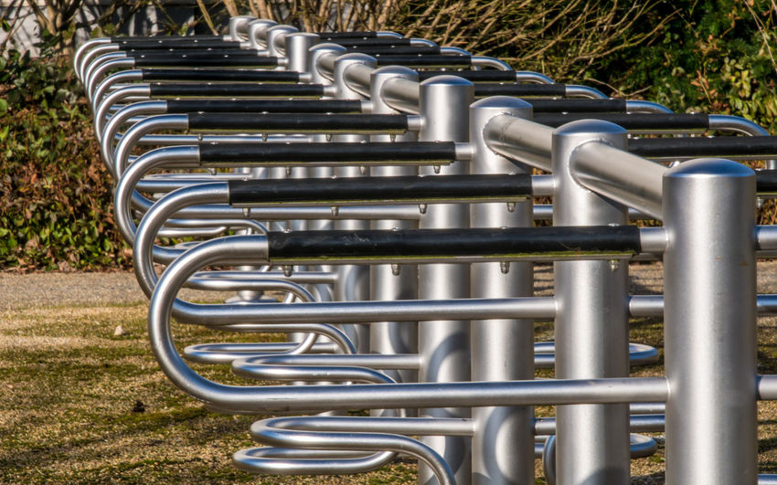 Berlin Photography In A Row Transportation Alloy Bicycle Rack Day Equipment Grass In A Row Industry Metal No People Park Park - Man Made Space Pattern Pipe - Tube Plant Shiny Silver Colored Steel