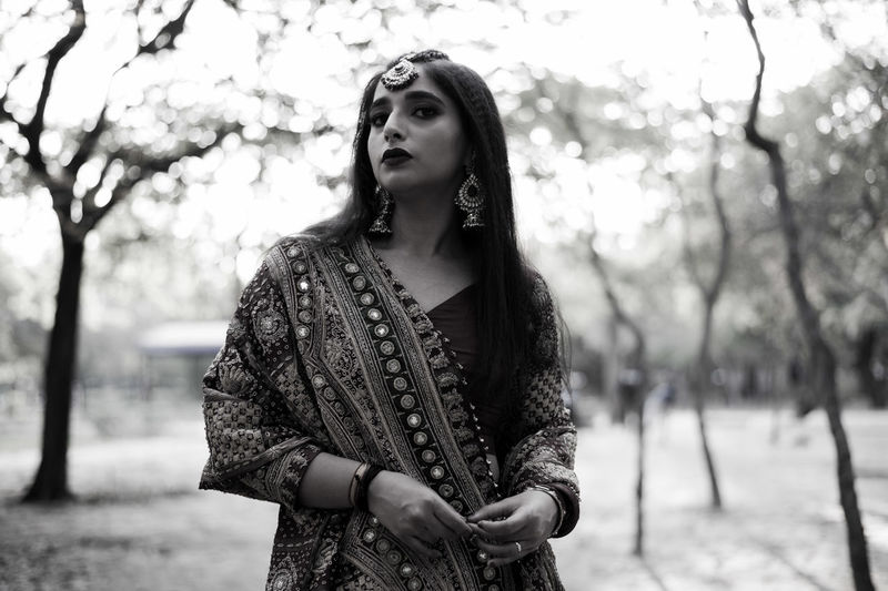 Portrait of young woman wearing traditional clothing standing outdoors