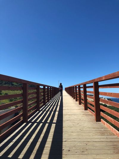 Starway to Heaven Puente Cielo Azul Blue Sky EyeEm Selects Sky Clear Sky Nature Sunlight The Way Forward Railing Blue Diminishing Perspective Bridge Tranquility Footbridge Wood - Material
