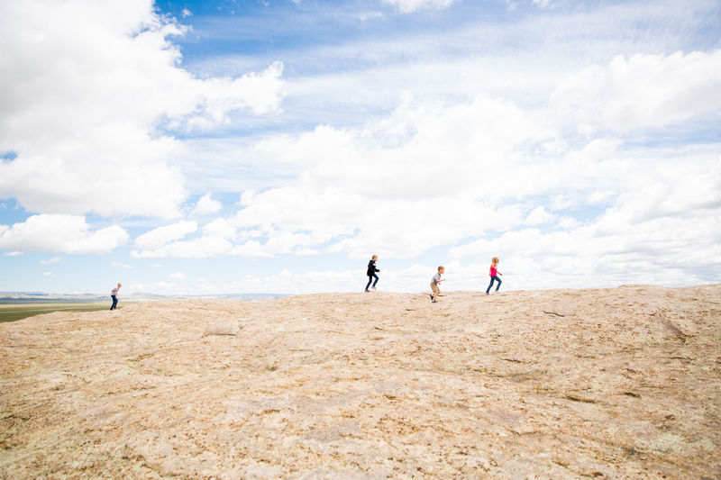 Childhood Children Cloud Day Enjoyment Family Freedom Landscape Leisure Activity Lifestyles Mountain Top Non-urban Scene On The Way Outdoors Playing Playing Tag Remote Running Scenics Sky Tourism Tourist Tranquil Scene Vacation Wyoming