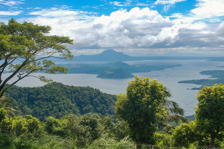 Beauty In Nature Clouds Clouds And Sky Lake Landscape Mountain Nature No People Outdoors Philippines Scenics Sky Taal Taal Volcano Tree Trees Vegetation Volcano