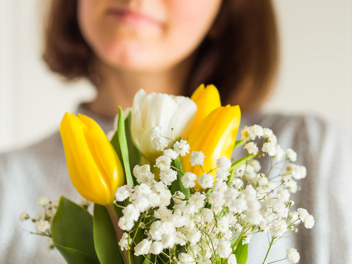 Close-up of woman holding flower bouquet