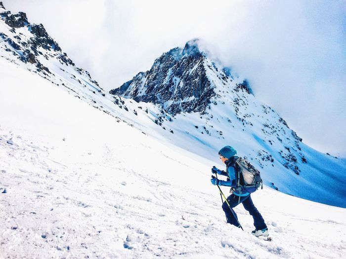 Man hiking on snow covered landscape