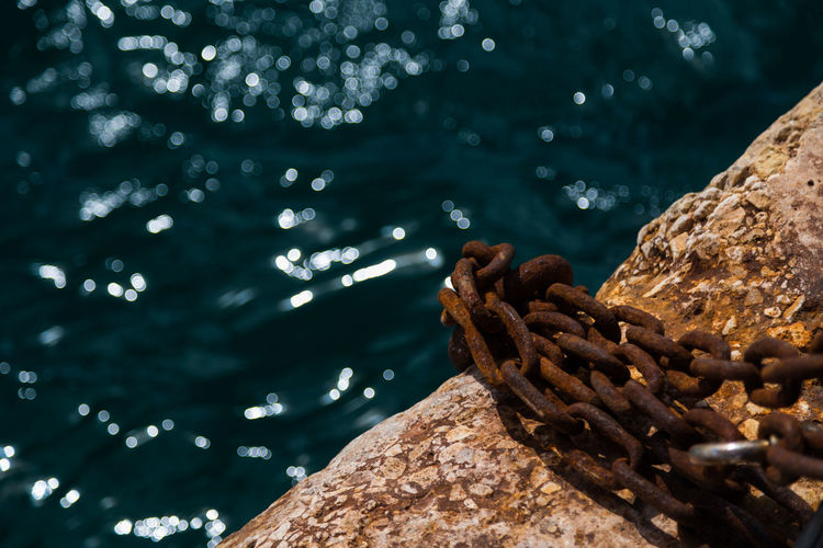 Close-up of rope tied up by sea