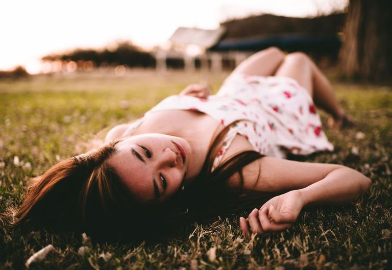 Relaxation Grass Leisure Activity Lifestyles Lying Down Field Resting Relaxing Light And Shadow Young Women Mood Women Who Inspire You Portrait Of A Woman New Talents EyeEm Best Shots EyeEmBestPics Young Adult Grassy Day Lying On Back Lawn Vacations Nature Outdoors Beauty