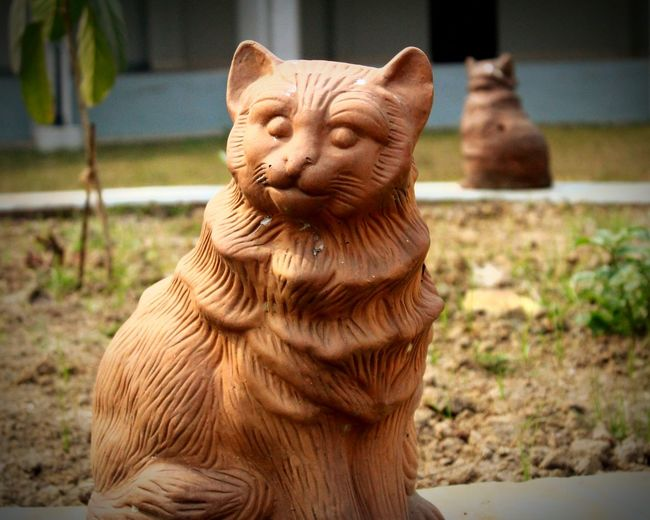 Close-Up Of Cat Sculpture In Garden