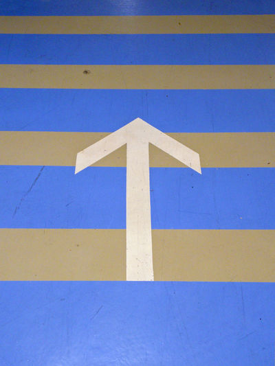Parking Garage Arrow Symbol Blue Close-up Day Guidance No People Outdoors Road Sign Signaling White Color Yellow