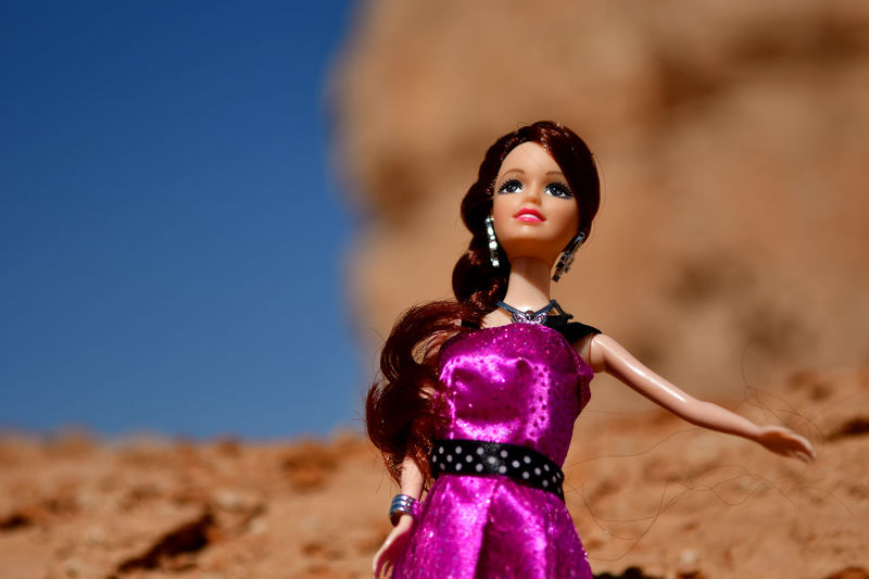 Gorgeous plastic doll on location shooting in the desert and having a fuchsia satin silk dress Doll Beautiful Woman Beauty Close-up Day Fashion Fashion Model Focus On Foreground Fuchia Glamour Gorgeous Girl On Location One Person One Young Woman Only Outdoors People Plastic Doll Portrait Satin Satin Look Sexygirl Shining Texture Silk Dress Young Adult Young Women