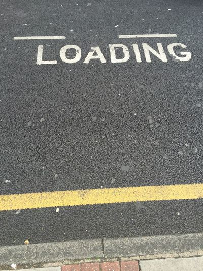 Loading bay road markings sign on tarmac Roadside Road Roadsign Loading Loading Bay Loadingbay