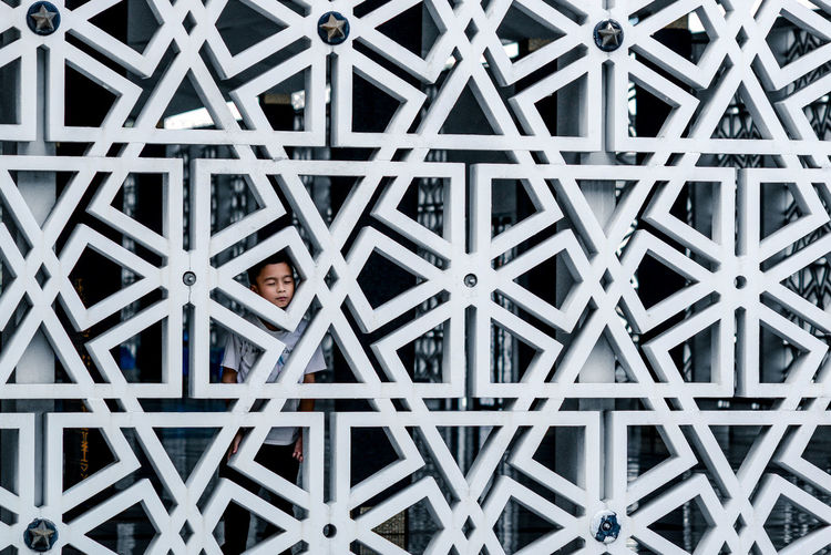 Happiness Indoors  Looking At Camera One Person Pattern Portrait Real People Smiling The Architect - 2017 EyeEm Awards Triangle Shape Geometry Geometric Shape Background Islamic Pattern Breathing Space