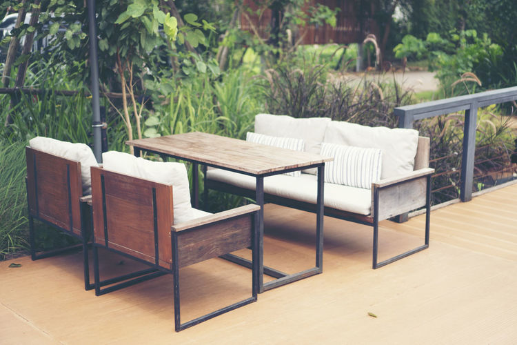 Seat Plant Chair Furniture Wood - Material No People Table Empty Absence Tree Day Nature Growth Outdoors Wood Relaxation Land Flooring Pillow Focus On Foreground Coffee Table