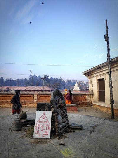 People working on building against sky