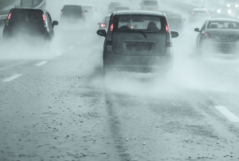 Noise effect. Blurred. Film Grain. Rainfall on the highway on a moving vehicle Car Cold Temperature Day Drop Fog Land Vehicle Mode Of Transport Motion No People Outdoors Rain RainDrop Road Snow Spraying Storm Street Transportation Water Weather Wet Winter