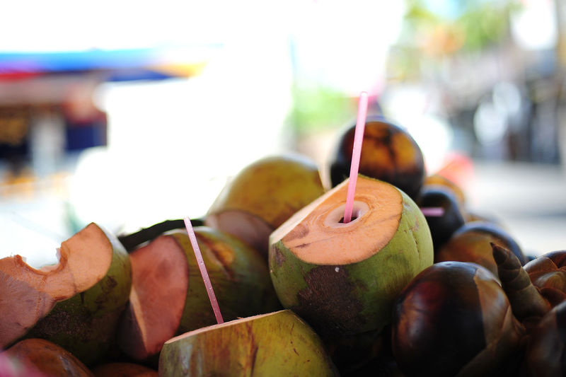 Coconuts drink Apple - Fruit Close-up Coconut Water Day Focus On Foreground Food Food And Drink Freshness Fruit Fruits Group Of Objects Healthy Eating Market Nature No People Outdoors Ripe Selective Focus Still Life Wellbeing