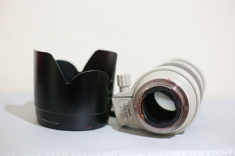 Close-up of camera on table against white background