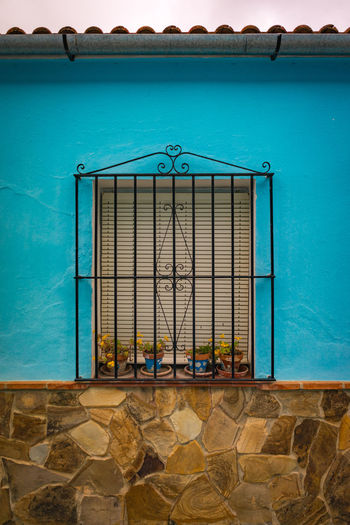 Blue wall with window Architecture No People Built Structure Entrance Building Exterior Day Building Water Door Closed Nature Sea Outdoors Gate Wall - Building Feature Travel Destinations Blue Security Railing Wall Window