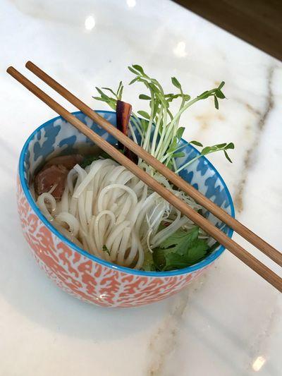 Vietnamese Pho Vietnamese Culture Pho Soup Noodles EyeEm Selects Food Food And Drink Freshness Indoors  Still Life Asian Food Japanese Food Chopsticks Bowl Herb
