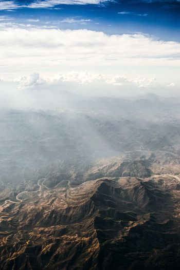 Aerial view of dramatic landscape against sky