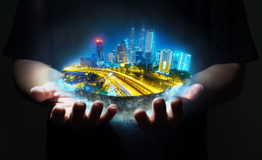 Architecture Black Background Building Building Exterior Built Structure Business City Cityscape Close-up Digital Composite Hand Holding Human Body Part Human Hand Illuminated Multi Colored Nature Office Building Exterior One Person Skyscraper Studio Shot Technology