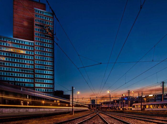 Railroad tracks against clear sky at dusk