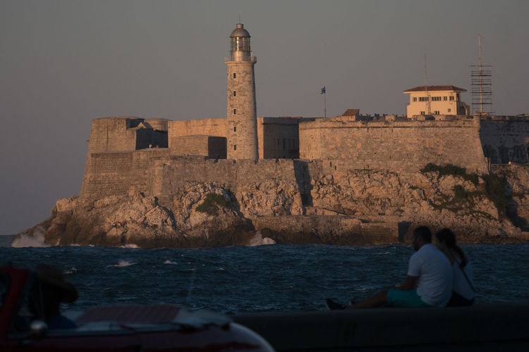 Malecón before sunset Afternoon Sunlight Architecture Castle Cuba Cuba Collection Day Focus On Background Fort History Malecon Men Outdoors People Sea Sunset Tourist Attraction  Travel Photography Unrecognizable People Vacations Water Wave