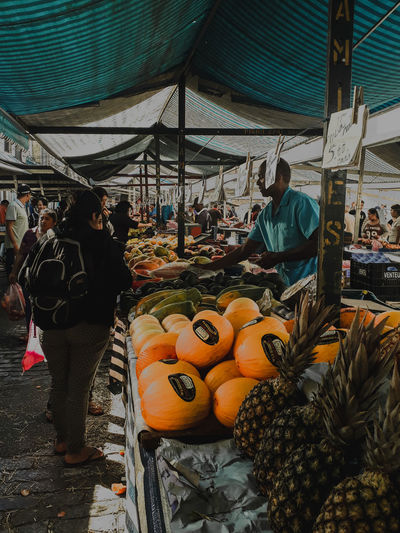 Rear view of people at market stall