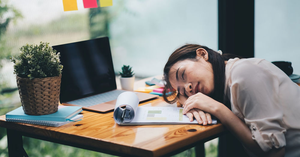Woman sleeping at office desk