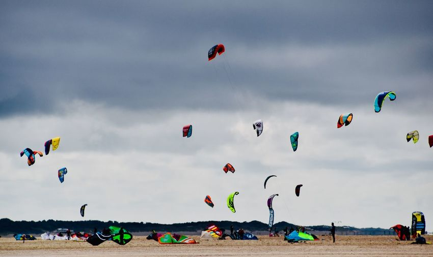 People paragliding against sky