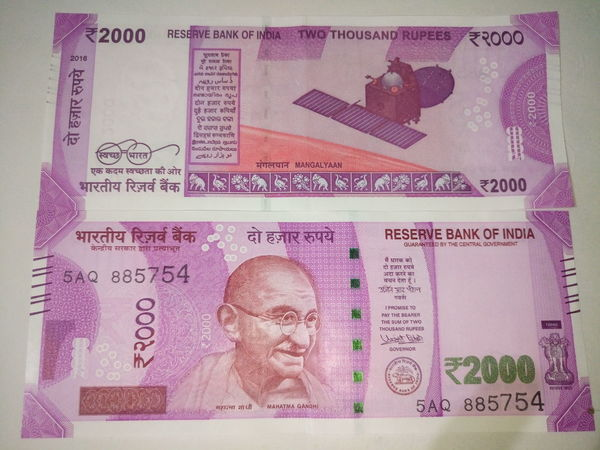 Indian two thousand rupee note 2000 Adult Adults Only Banknote Business Currency Indian Digital Composite Finance Finance And Economy Full Length Indian Culture  Indian Currency Indian Two Thousand Rupee Note Men New One Man Only Only Men Paper Currency People Pink Color Savings Success Technology Two Thousand Rupee Note Wealth