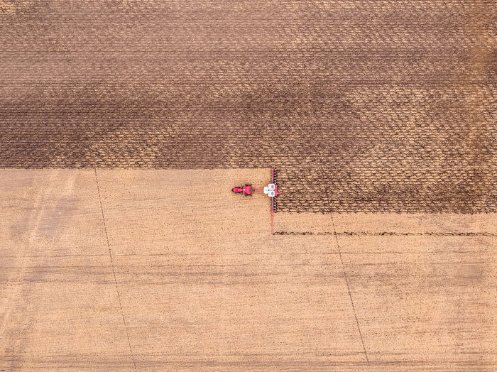 Aerial view of combine harvester harvesting at farm