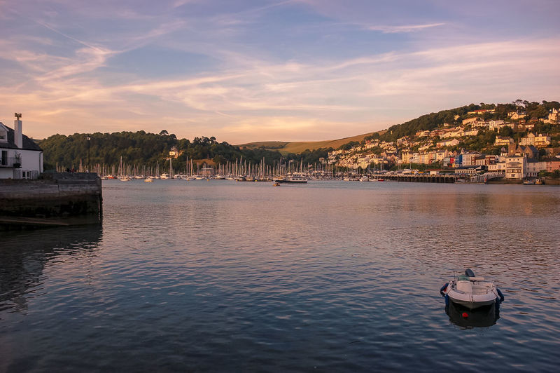 A view of Dartmouth in South Devon at sunset. Beautiful Boat Boats Dartmouth Devon Estuary Holiday Holidays Kingswear Picturesque River River Dart Riverscape Scenic South Devon Sunset Tranquil Scene Vacation