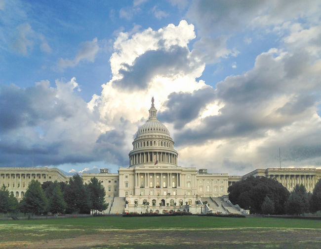 Back of US Capitol Building with Dramatic Sky Cloudscape Dramatic Sky US Capitol Building No People Outdoors History Travel Destinations Government Sky Cloud - Sky Building Exterior Architecture Built Structure Dome