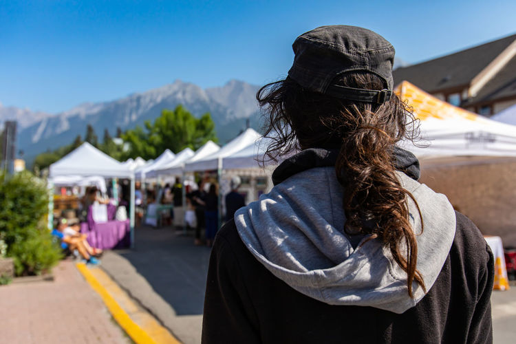 Rear view of woman looking at market stall