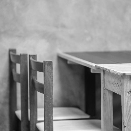 Monochrome Photography Focus On Foreground No People Table Chair Wood Interior Concrete Wall Daylight